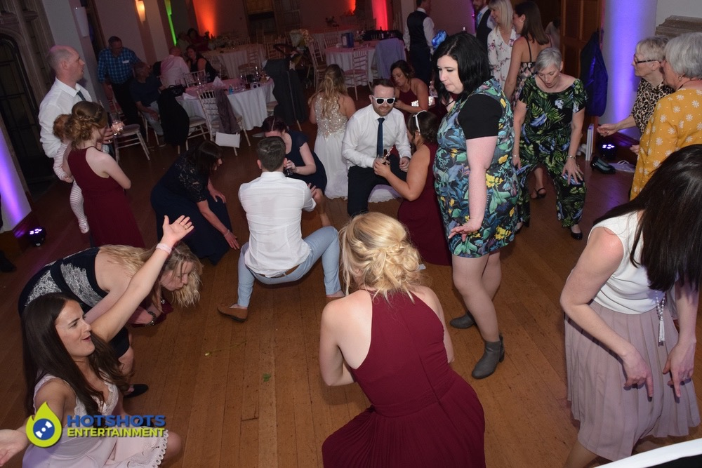 Wedding guests dancing at a wedding in Coombe Lodge with DJ Morf.