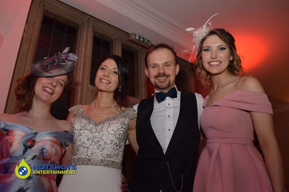 Coombe Lodge Wedding with so much fun. Bride and groom with their guests.