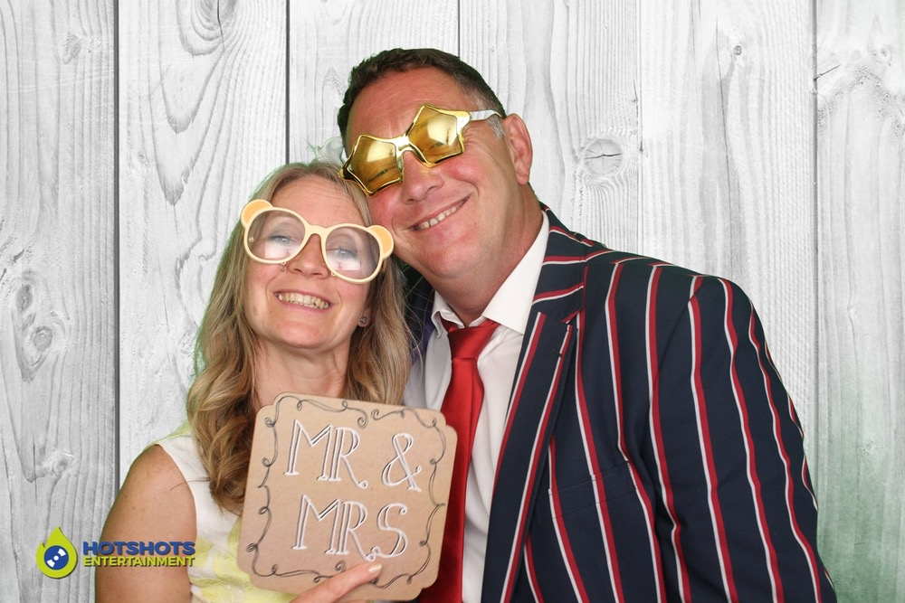 Wedding couple loving the photo booth