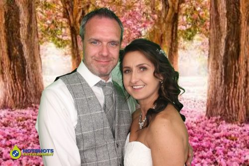 The happy couple. Bride and Groom in the photo booth with green screen.