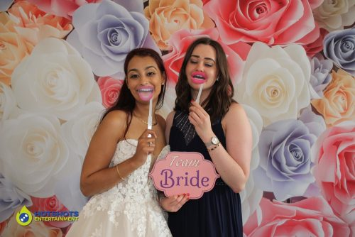 Bride and friend in the photo booth