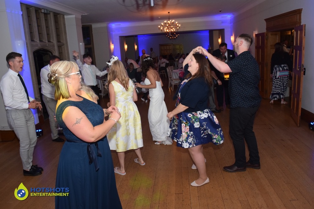Wedding guests dancing around