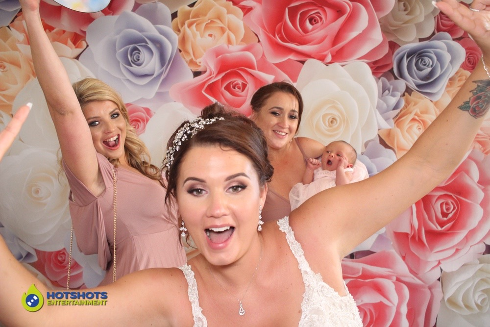 Bride and bridesmaids in the photo booth