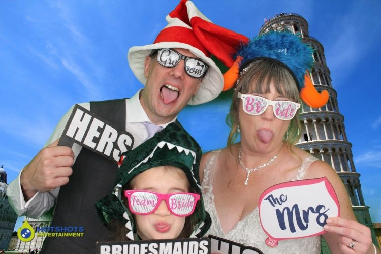 Bride and Groom having fun in the photo booth hire