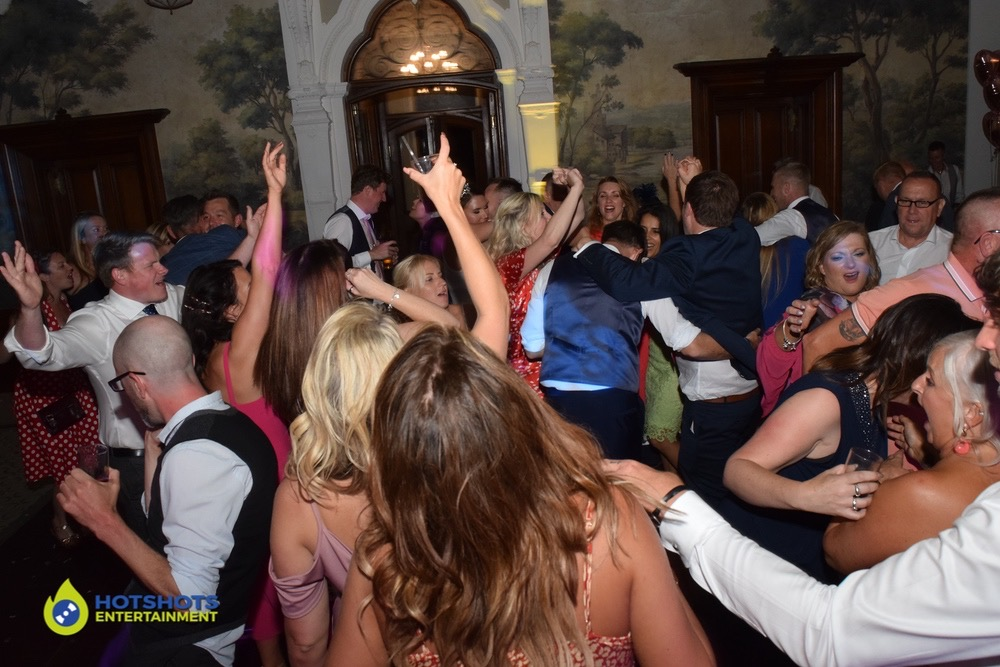 Wedding guests having a really good time dancing away