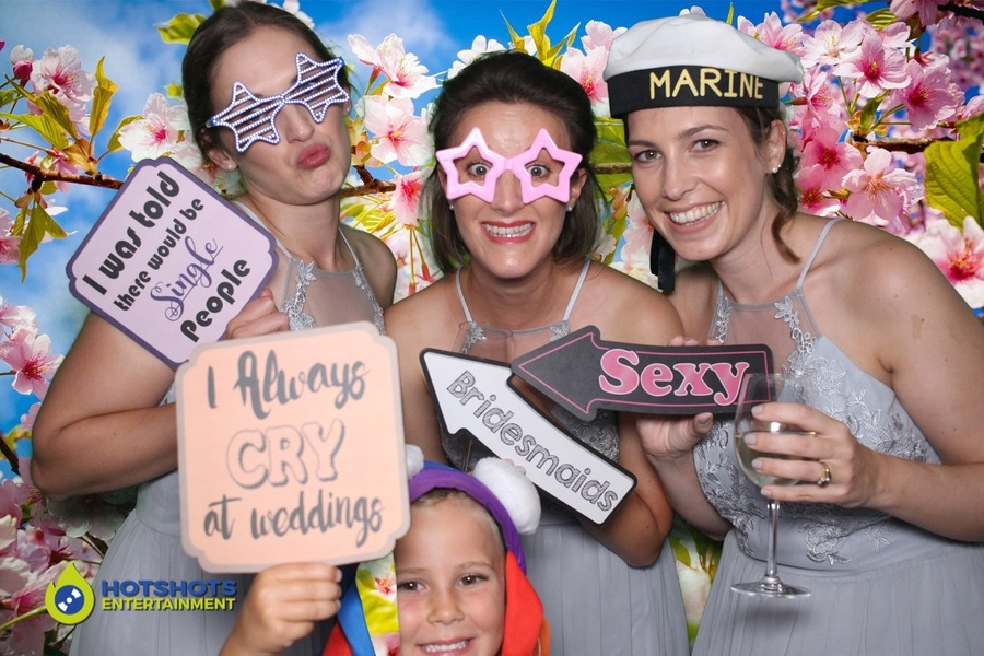 Wedding bridesmaids enjoying the photo booth with green screen