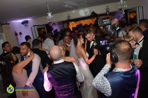 Bride and groom dancing with their guests at Homewood Park.
