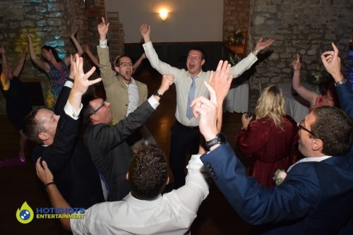 Wedding guests having a really good time on the dance floor