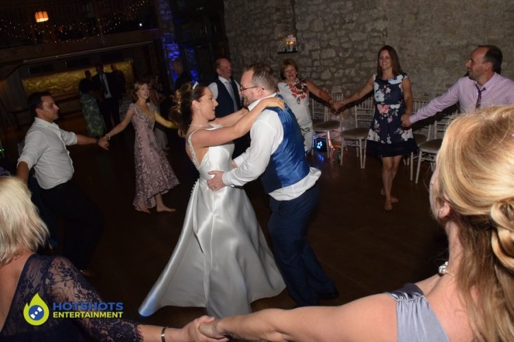 Wedding bride and groom having the best time ever on the dance floor
