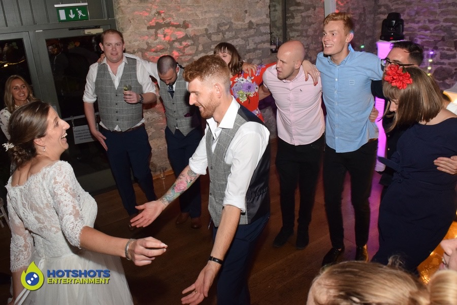 The happy couple dancing the night away at Priston Mill with their wedding guests