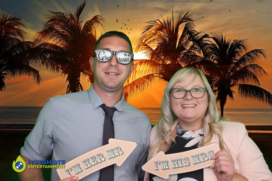 Wedding guests having fun in the photo booth with green screen and props.