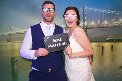 Bride and Groom in the photo booth with green screen