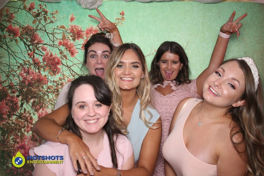 Bridesmaids having fun in the photo booth