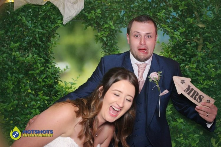 Bride and Groom in the rustic photo booth with green screen