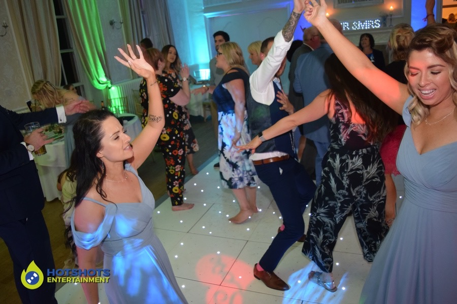 Wedding guests dancing the night away on the LED dance floor
