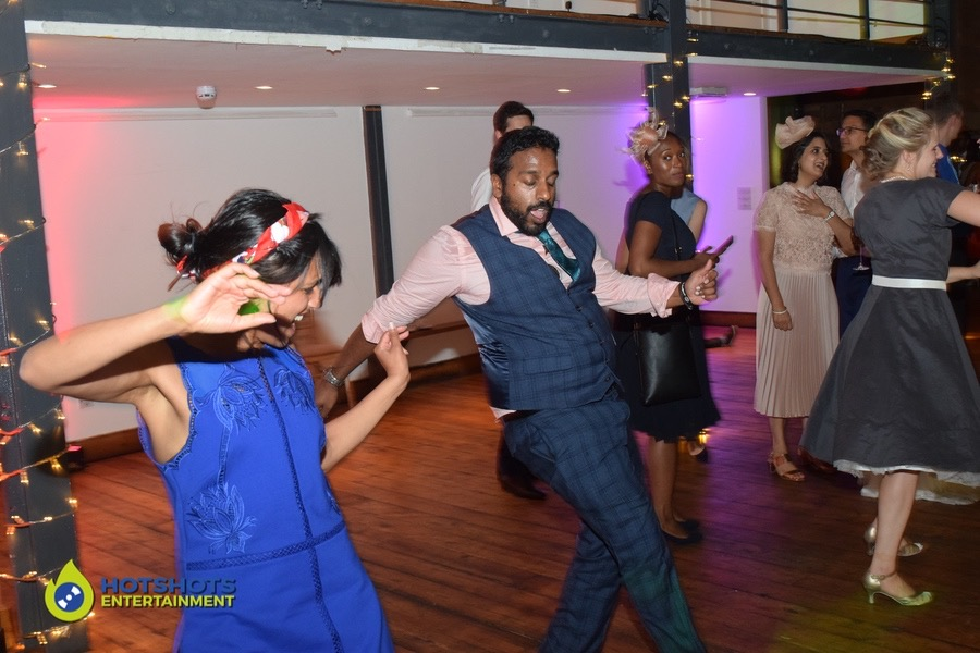 Wedding guests having the best time, showing their moves off at a wedding.