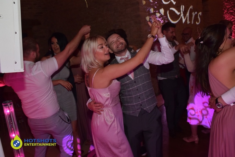 Wedding guests joining for the first dance song with the bride and groom