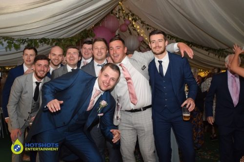 The boys at a marquee wedding having a blast