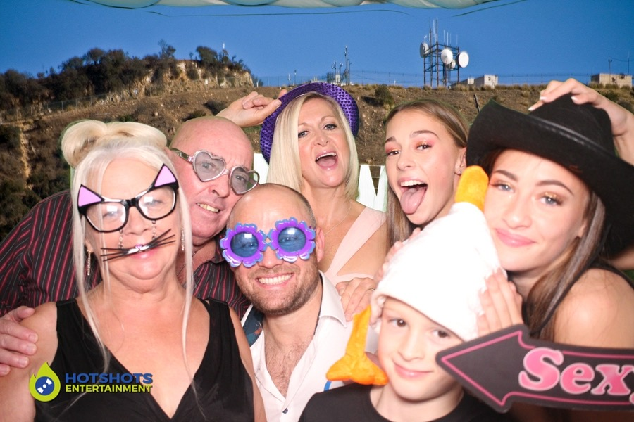 Family time in the photo booth using the green screen.