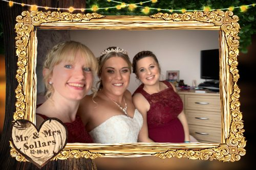 Bride with bridesmaids taking a selfie