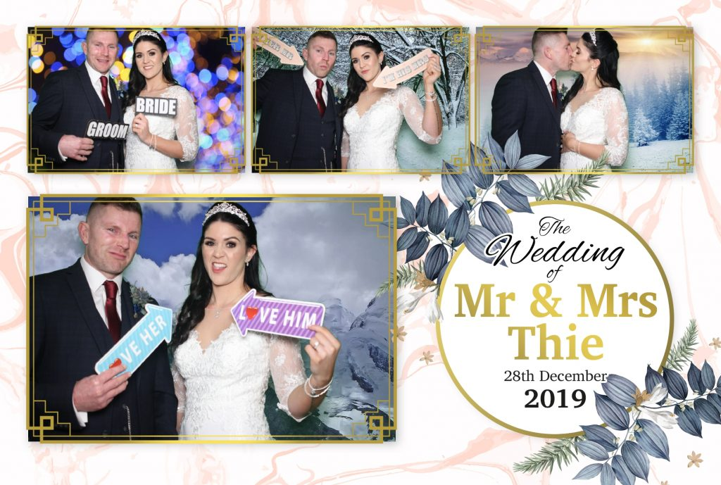 Happy couple in the photo booth with their chosen template design