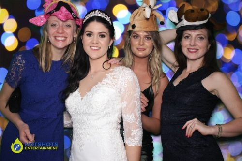 Wedding guests having a great time in the photo booth hire