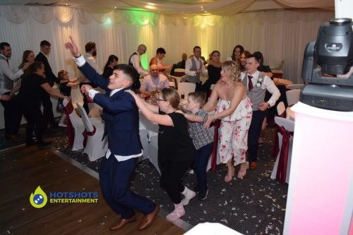 wedding guests doing the conga