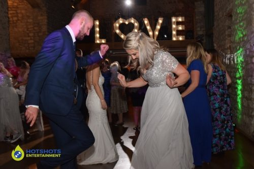 Wedding guests having the best time at Priston Mill