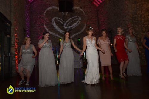 Bride and Bridesmaids doing a dance routine