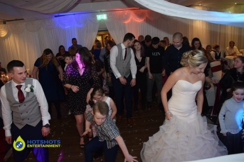 Wedding guests having a great time dancing.