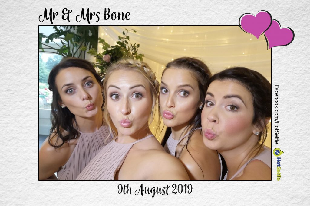 Bridesmaids having a selfie, looking good at Homewood park for a wedding.