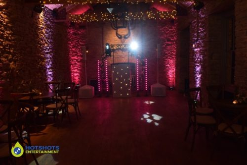 Wedding disco set up at The White Horse Barn in Hambrook. March 2020 wedding in a barn.