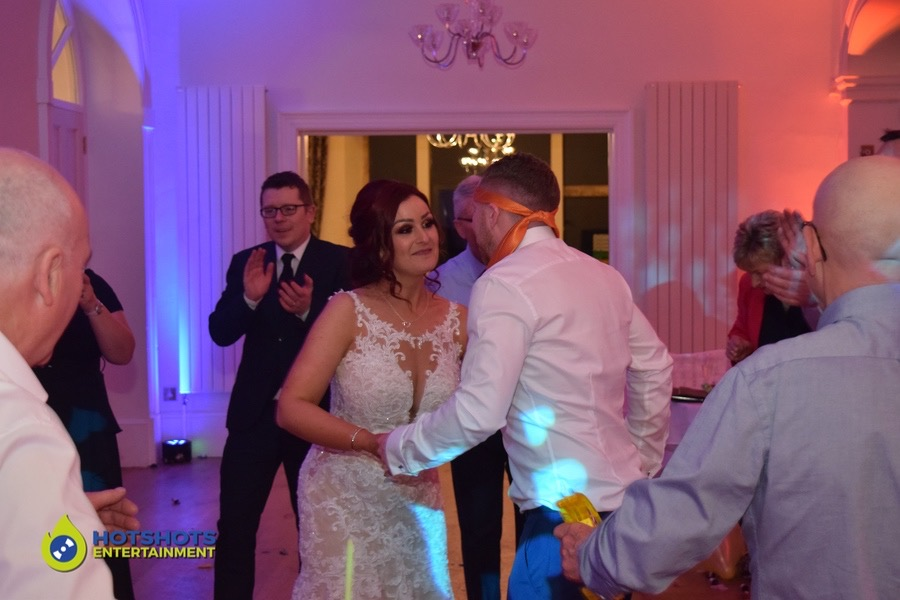 The bride and groom look so happy on the dance floor