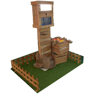 Wooden rustic photo booth with fake grass and wooden crates with Apples in hiding the printer.